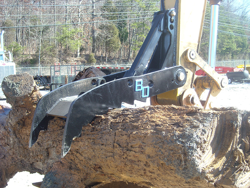 Excavator Thumb with tree trunk